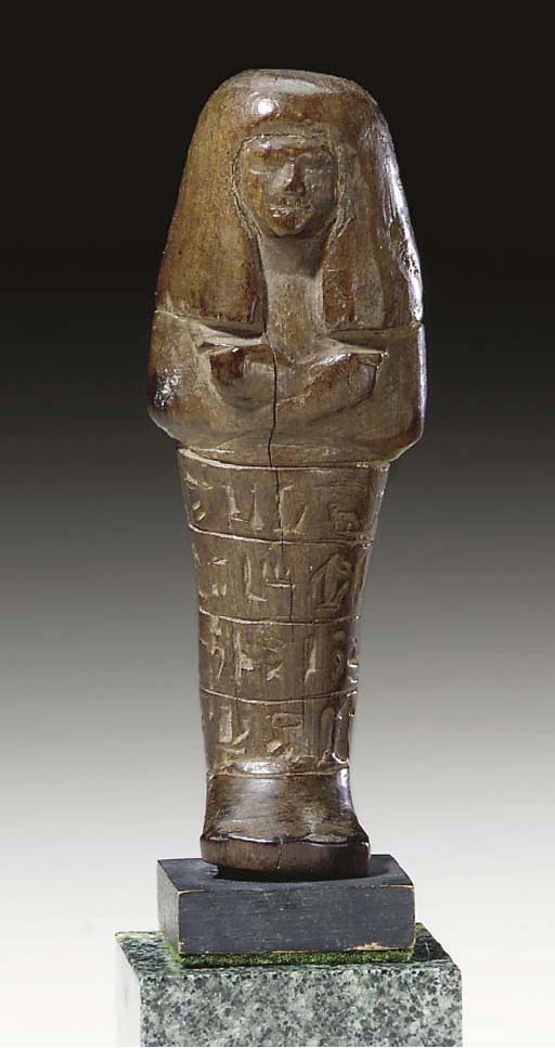 AN EGYPTIAN WOOD SHABTI FOR NO