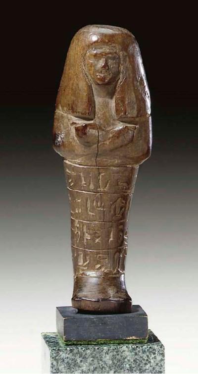 AN EGYPTIAN WOOD SHABTI FOR NO