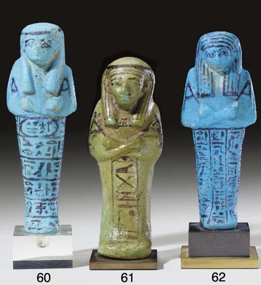 AN EGYPTIAN FAIENCE SHABTI FOR