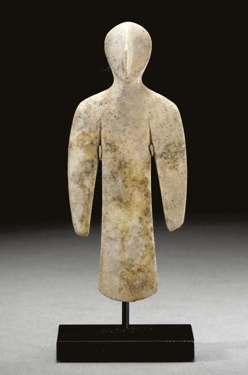A BACTRIAN WHITE STONE IDOL OF