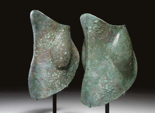 A PAIR OF GREEK BRONZE ANKLE G