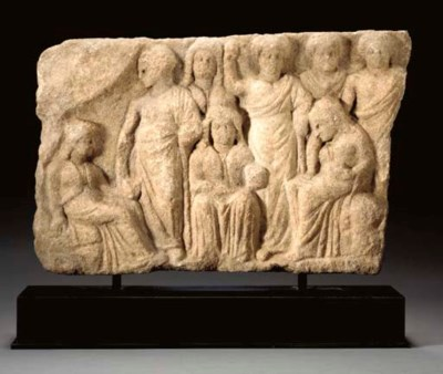 A GREEK MARBLE VOTIVE RELIEF