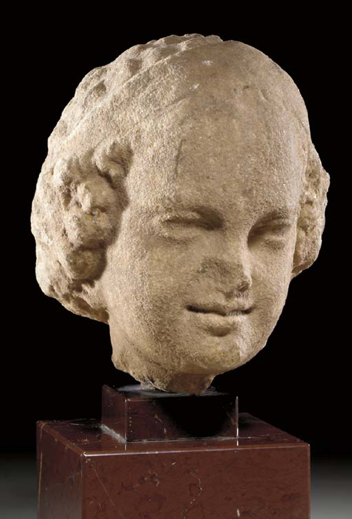 A GREEK MARBLE HEAD OF A YOUNG GIRL