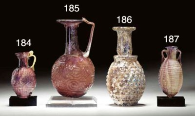 A ROMAN GLASS GRAPE FLASK