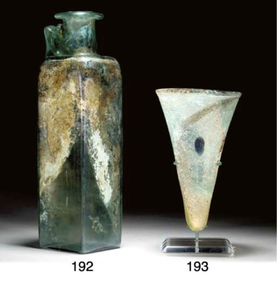 A LARGE ROMAN GLASS BOTTLE