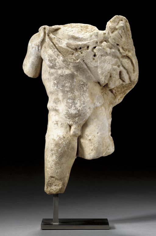 A ROMAN MARBLE TORSO OF SILVAN