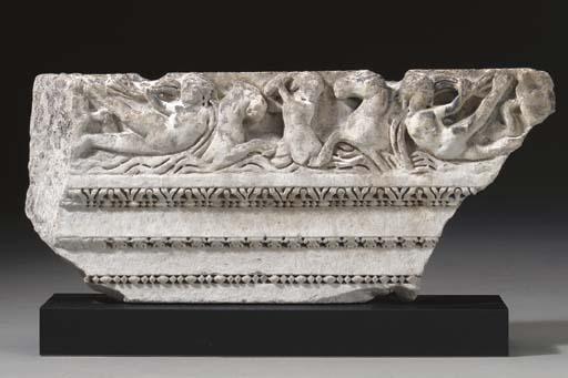 A ROMAN MARBLE ARCHITRAVE FRAG