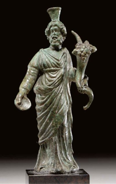 A ROMAN BRONZE FIGURE OF SERAP