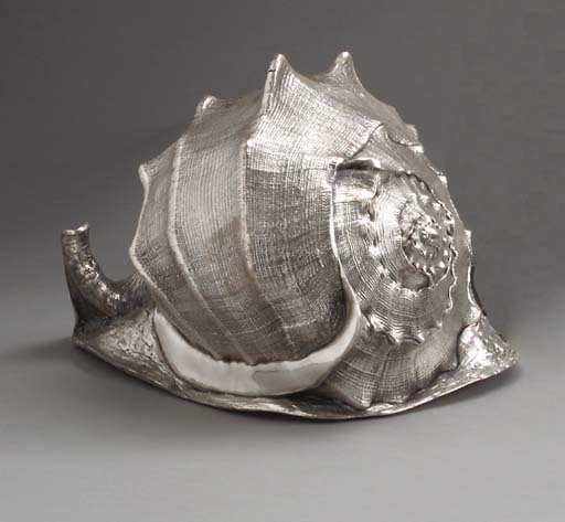 A SILVER-COATED SEASHELL, BY P