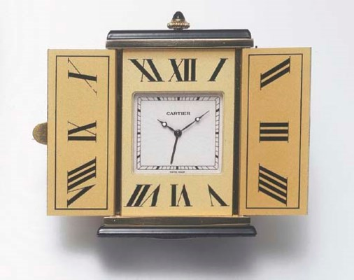 A GILT-METAL ALARM CLOCK, BY C