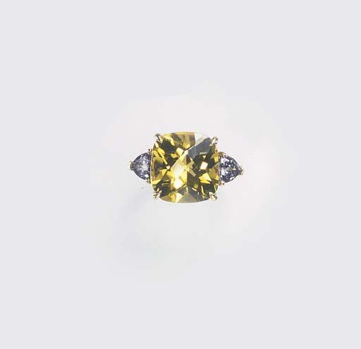 A CITRINE AND TANZANITE RING,