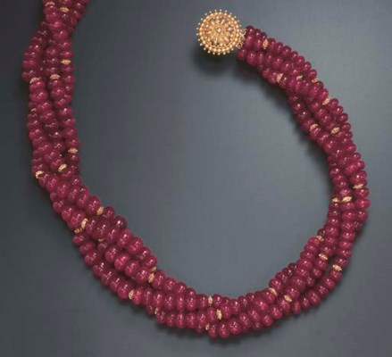 A MULTI-STRAND RUBY NECKLACE
