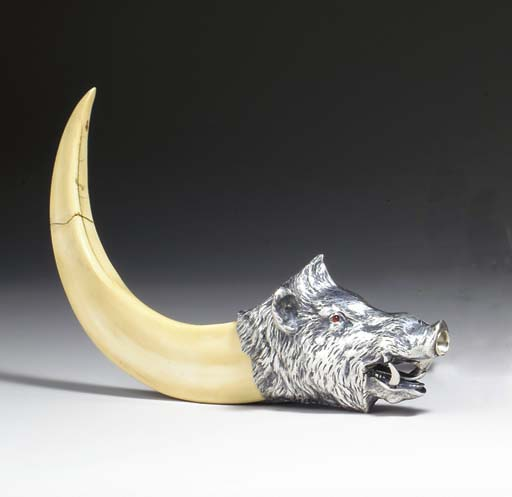 AN IVORY AND SILVER MOUNTED BO