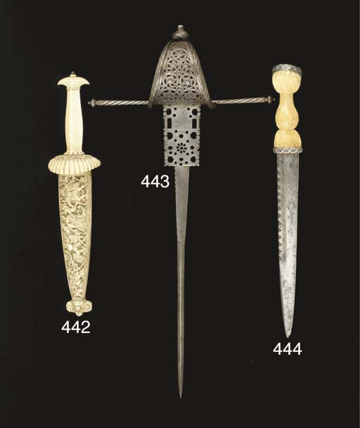 A CARVED IVORY DAGGER AND SCAB