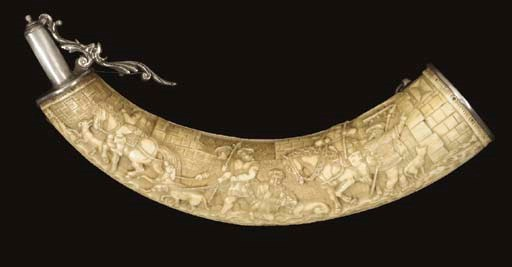 A SILVER-MOUNTED CARVED IVORY