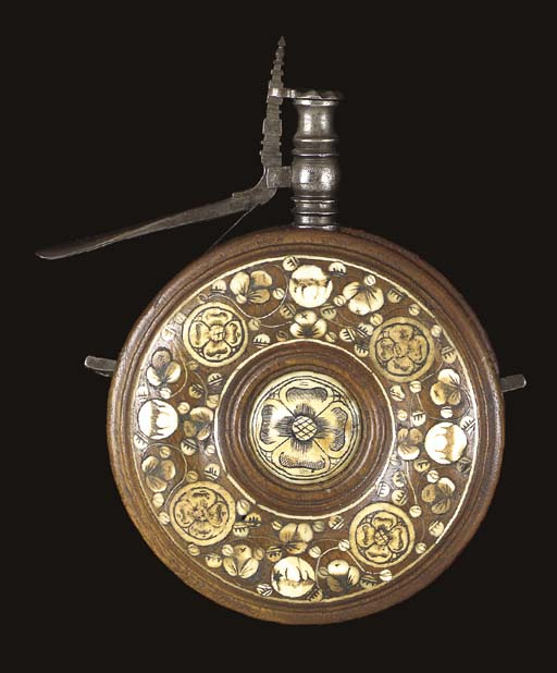 A GERMAN CIRCULAR POWDER-FLASK