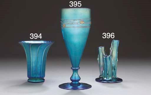 A DECORATED BLUE AURENE GLASS