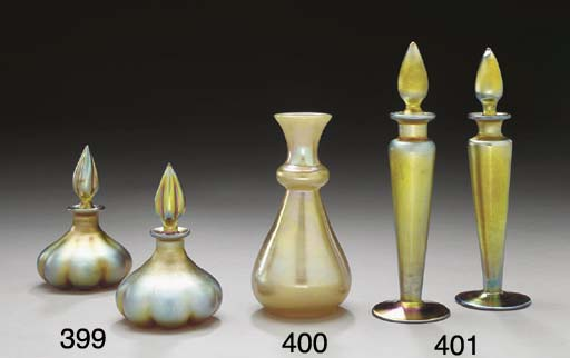 A PAIR OF GOLD AURENE PERFUMES