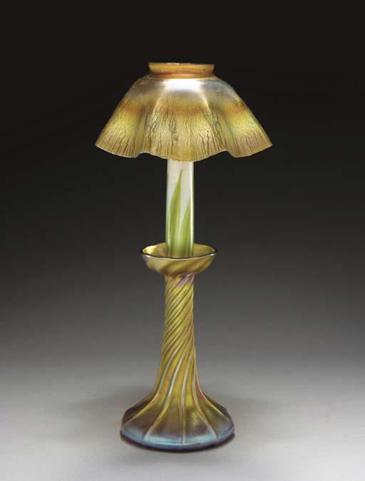 A GOLD FAVRILE GLASS CANDLE LA