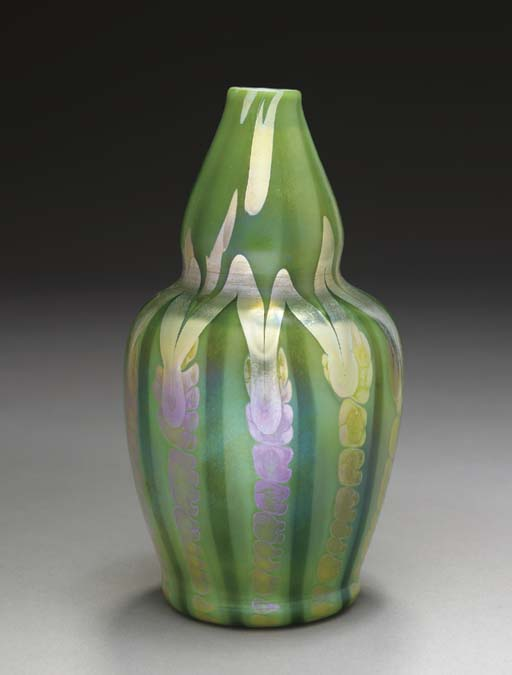 A DECORATED GREEN FAVRILE GLAS