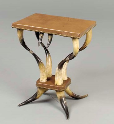 A HORN AND LEATHER SIDE TABLE