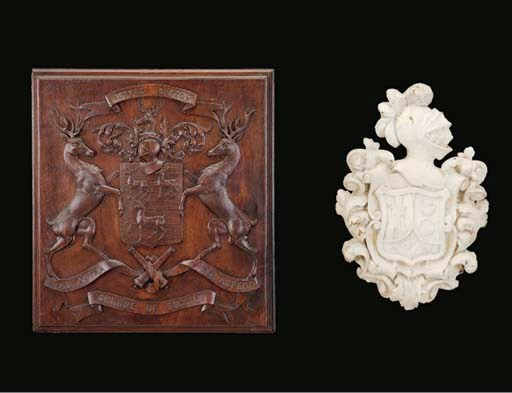 A CREAM-PAINTED COAT-OF-ARMS A