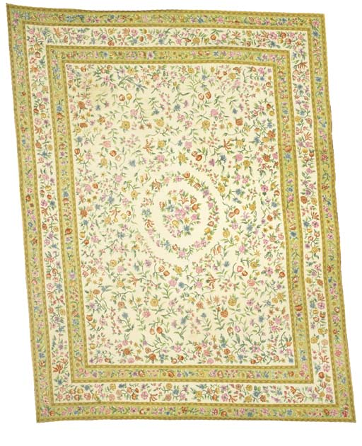 A NEEDLEPOINT CARPET MADE BY A