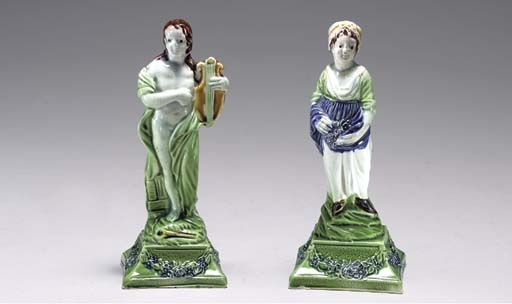 TWO PEARLWARE FIGURES ON GREEN