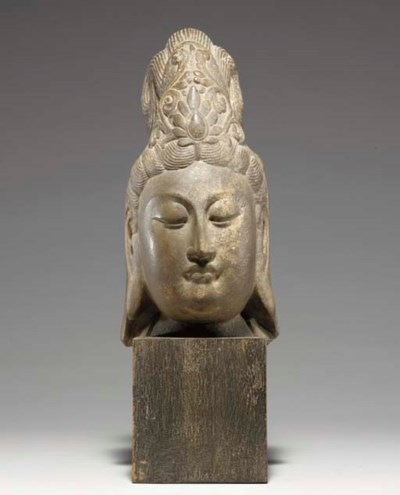 A CARVED STONE HEAD OF BODHISA