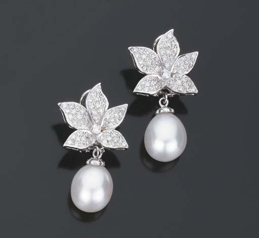 Paio di orecchini con perla coltivata e brillanti