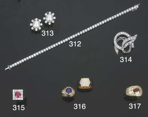 Spilla in oro e diamanti