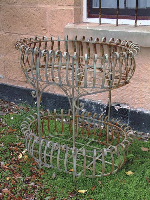 AN OVAL TWO-TIER WROUGHT IRON