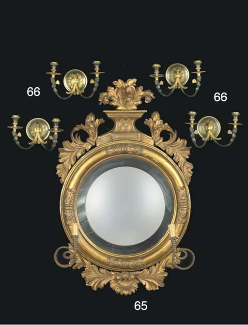 An giltwood butler mirror