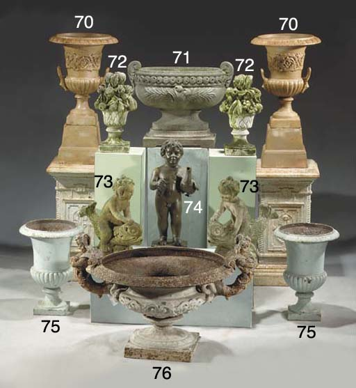 A white-painted cast-iron vase