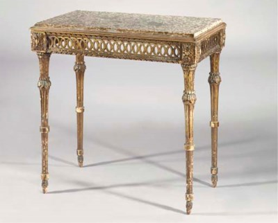 An Italian carved giltwood con