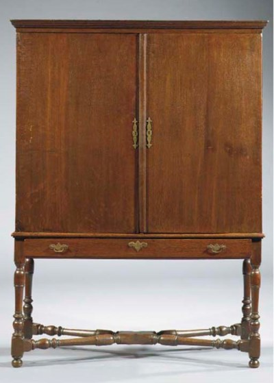 A Dutch oak cabinet-on-stand