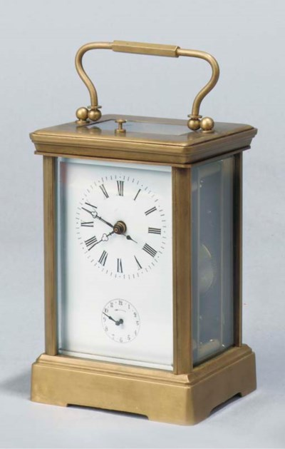 A brass carriage clock with al