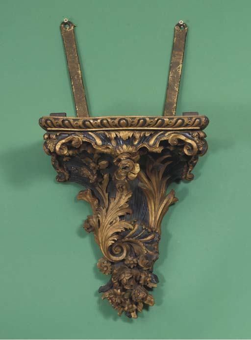 A Dutch carved wood and parcel
