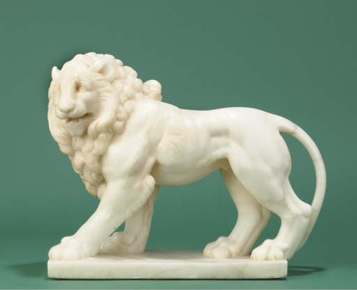 A carved alabaster figure of a