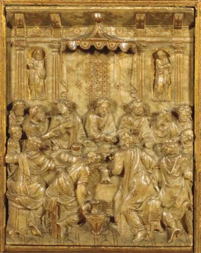 A parcel-gilt carved alabaster