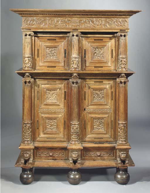 A Dutch oak and ebony cupboard