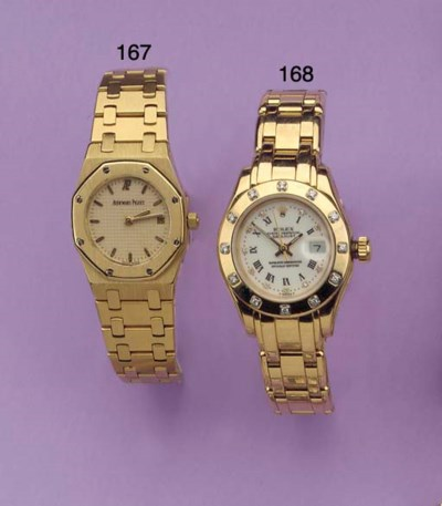 (2)  A LADY'S 18K GOLD WATERRE