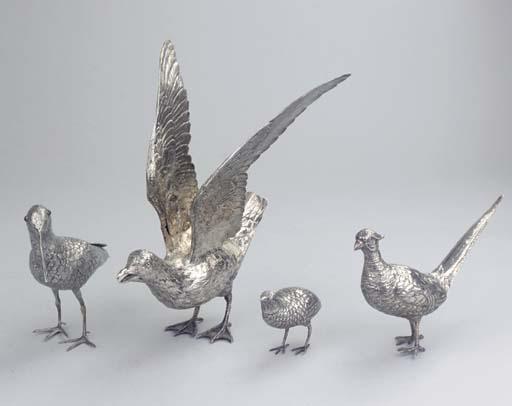 (4)  Three silver castors shap