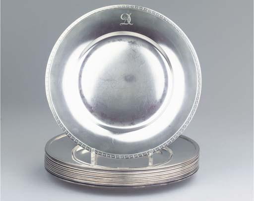 (12)  A set of twelve Norwegian silver dinner-plates