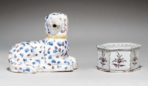 (2) A Delftware model of a dog