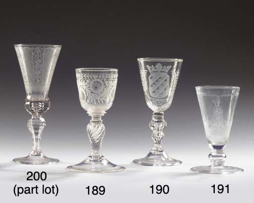 (2) A Dutch-engraved faceted armorial goblet and a Saxon engraved faceted goblet