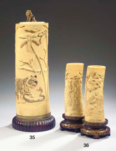 A pair of ivory brushpots