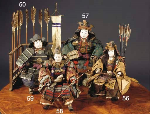 A collection of festival doll