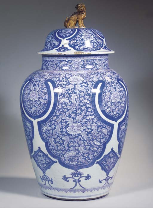A large blue and white jar and