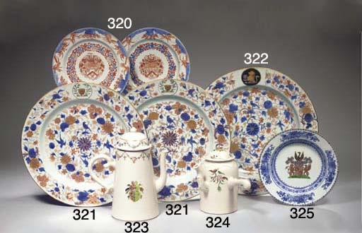 A pair of Imari armorial dishe